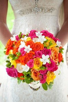 Summertime means bright colors! Go for a bold bridal bouquet with orange, pink and yellow wedding flowers. | Simple Elegance Floral & Event Design, Wisconsin