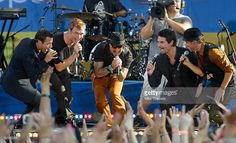 Singers Howie Dorough, Nick Carter, A. J. McLean, Kevin Richardson, and Brian Littrell the Backstreet Boys perform on ABC's 'Good Morning America' at Rumsey Playfield, Central Park on August 31, 2012 in New York City.