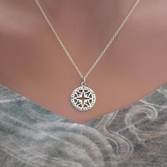 This is a beautiful Sterling Silver Openwork Compass Pendant Necklace. Both the charm and the necklace are Sterling Silver. Measurement of Charm in mm: Length: 22 Width: 15 Height: 1 (length includes