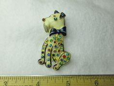Celluloid Rhinestones Scotty Dog Brooch Pin. I've seen these listed as French. They're starting to grow on me.