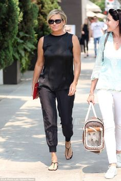 Retail therapy: Gigi's mother Yolanda Hadid was spotted out shopping with a gal pal who carried her little white pup in a special bag in Beverly Hills, on Saturday 50s Outfits, Chic Outfits, Summer Outfits, Fashion Outfits, Older Women Fashion, Womens Fashion, Autumn Winter Fashion, Celebrity Style, Fashion Black