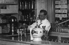 Old Time Soda Jerk Adding Fountain Syrup To Make Soda Beverage