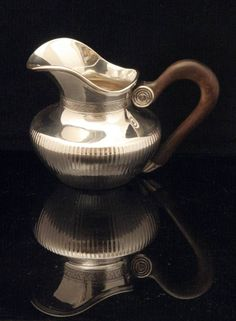 Puiforcat Tea Set - The elegant sugar bowl with vermeil (gold plated sterling silver) interior measures roughly 12.5 cm. high, 16.5 cm. across, including the handles  and weights roughly 593 grams.