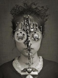 Like Clock parts or mechanical parts exposed.   Clockwork eyes by Mick Ryan
