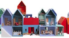 Hase Weiss beautiful and modular dollhouses come in a rainbow of pretty colors and can be reconfigured in countless ways.