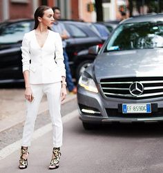 Start fresh by wearing an all white, crisp suit with snakeskin heels this NYE