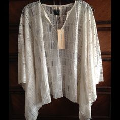 NWT Urban Mangoz Lace Poncho size L Ivory Lace poncho, new with tags. Hand wash Urban Mangoz Sweaters Shrugs & Ponchos