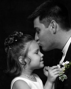 groom flower girl picture. so sweet!