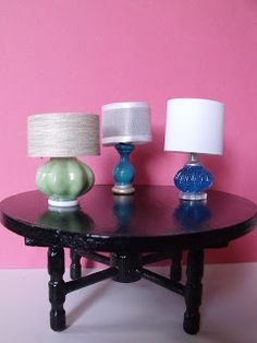 Lampshade Ideas - Left: wallpaper shade and ceramic drawer knob glued onto a white button; Center: ribbon shade and painted wood base; Right: white cardstock shade and a metal pushpin, blue plastic bead, and clear button base.
