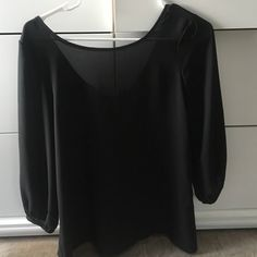 Sheer top with Bow accent Beautiful sheer black top, with a low back and bow accent. 3/4 sleeve lightly worn in great condition. Tops Blouses