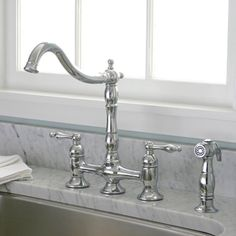 Two-handles make it easy to adjust the Charelstown bridge-style faucet to the ideal temperature. Designed with wear-resistant brass, this durable chrome faucet will add modern style to your kitchen space. Kitchen On A Budget, Kitchen Redo, Kitchen And Bath, New Kitchen, Kitchen Ideas, Kitchen Inspiration, Kitchen Stuff, Kitchen Planning, Ranch Kitchen