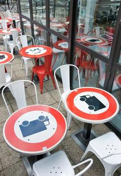 Metal road signs used as table tops at Le Dome Bistro, France.