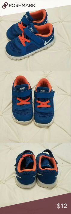 Nike Tennis Shoes Blue Orange White Velcro Nike Tennis Shoes  Blue Orange White  Size 7 Velcro closure  Great condition Nike Shoes Sneakers