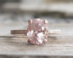 13 Etsy Boutiques to Shop Gorgeous Engagement Rings Love this oval-shaped pink diamond engagement ri Pink Diamond Engagement Ring, Wedding Rings Solitaire, Diamond Solitaire Rings, Solitaire Engagement, Vintage Engagement Rings, Bridal Rings, Pink Diamond Ring, Ruby Rings, Pink Rings