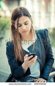 young beautiful woman using smart phone in the city - stock photo BUY IT FROM $1 ON SHUTTERSTOCK