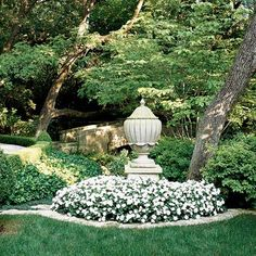 A beautiful white garden with an urn focal point. My favorite combination.  firstcomeflowers.typepad.com