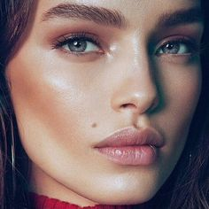 Dewy skin Pink lips glossed  Brown blusher