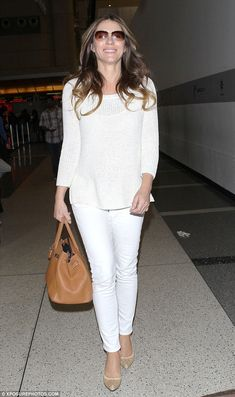 Jet-set perfection: Elizabeth Hurley made for a stylish traveller as she left Los Angeles ...