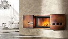 Photo of Chazelles Wood Burning Wall Hanging Fireplace With Sliding Doors from gallery of Stunning Ideas for Wall Hanging Fireplace. Chazelles wood burning wall hanging fireplace with sliding doors Outdoor Wood Fireplace, Indoor Outdoor Fireplaces, Small Fireplace, Fireplace Ideas, Metal Fireplace, Fireplace Doors, Fireplace Furniture, Mantel Ideas, White Fireplace