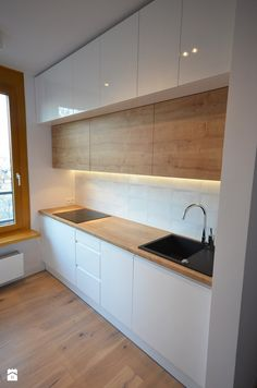 Love the timber fronts to match the worktop, and the black sink.