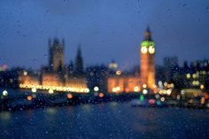 Palace of Westminster at night during a rainstorm.