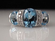Beautiful Blue Topaz three stone ring
