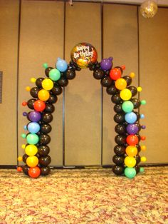 "Jan Iiams' LINK-O-LOON® air-filled arch with Betallic rounds in 11"" and 5"" brilliant colors."