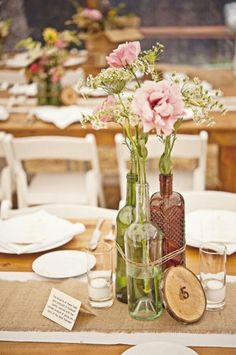 i love the idea of the center piece, i think clear jars and mixed sizes Leighton - Get some cheap flowers at Costco a day or two the day before and stick in here. Just have the vases ready to go. Maybe tie them up with some pretty plum colored ribbon. You just need springy flowers to put in them.
