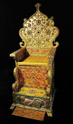 The Naderi Throne of Iran. Fashioned of wood, covered with gold, and encrusted with jewels, it was made by the order of Fat'h Ali Shah Qajar.  Among the 26,733 jewels covering the throne are four very large spinels on the backrest, the largest of which is 65 cts,  and four very large emeralds, the largest of which is approximately 225 cts. The largest ruby on the throne is 35 cts. The throne was kept in the Golestan Palace but is now in the National Treasury of the Central Bank of Iran.