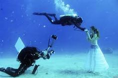 Eilat, Israel A model opens her mouth to breathe from a scuba tank as Israeli photographer Johannes Felten (L) takes pictures during an unde. Underwater Model, Underwater Photographer, Underwater Photos, Eilat, Sea Photo, Photography Competitions, Photo Competition, Red Sea, Greatest Adventure