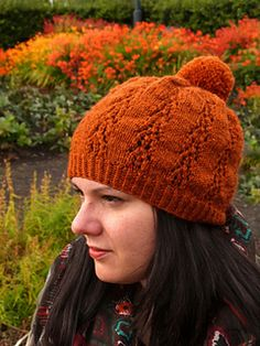 Top Hygge is a slouchy hat knitted in the round. It features an easy lace pattern and a cheeky pompom on top.