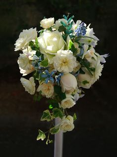gorgeous white and blue wedding bouquet flowers, lovely roses