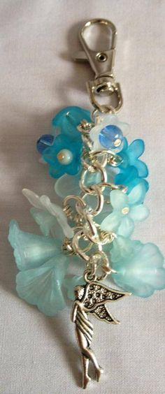 Pale blue and white lucite flowers bag charm with silver plated fairy charm £4.00