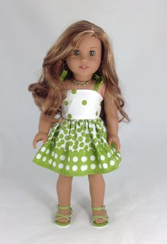 Green and white polka dot and floral bandeau dress by MjsDollBoutique18T on Etsy. Made from the Easy As Pi Bandeau Dress pattern. Get it at http://www.pixiefaire.com/products/easy-as-bandeau-dress-18-doll-clothes. #pixiefaire #easyaspibandeaudress