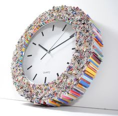 Clock wall art, made from recycled magazines