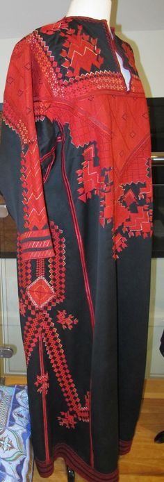 I purchased this Syrian dress while in Syria 2011 it took the lady who made the dress 12 months and she cross stitched in silk thread. The work is stunning. I have the dress permanently on display in my sewing room. I often wonder what became of her and the family. I was fortunate enough to fly out to safety when the war started