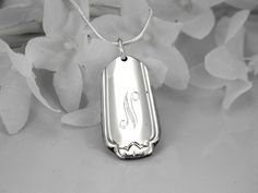 Pendant made from a spoon handle. LOVE.