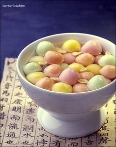 Travel Asian food 원소병 Wonsobyeong (Korean rice cake ball in honey beverage for the first lunar full moon)