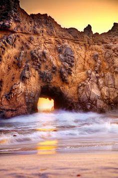 Sea arch rock at Pfeiffer Beach in Big Sur, CA