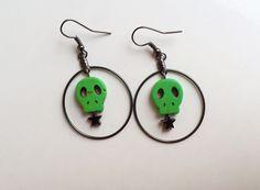 Green skull and hematite star hoop earrings by CraftingAwayTheFeels on Etsy