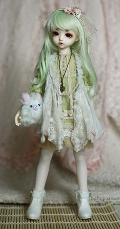 Very appealing in this innocent lace dress doll .. Much Ado About Resin