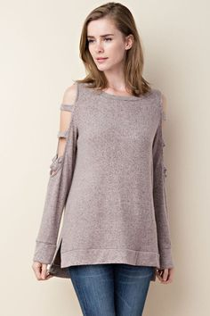 Long sleeve cold shoulder to with slight hi-lo hemline and side slits. Features a cutout slash design down the sleeves. Brushed 2-tone knit fabric...SUPER SOFT! Blush/rose mixed with a dark grey. Our new favorite softy.