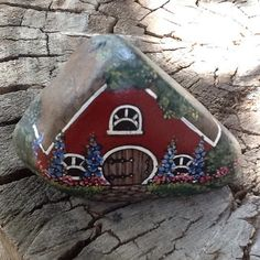 The little red house is the perfect color and size to add charm to a potted plant. What was your average houseplant becomes a towering forest over the enchanted home of a magical being, like a little fairy or a gnome.  It features a round wood door with black hinges, unique shaped windows, a cobblestone path, and grass and landscaping of grass and flowers.  Hard stone painted and coated with clear acrylic is pretty durable and can stand up to watering and outdoors.  It measures 2 3/4 tal...