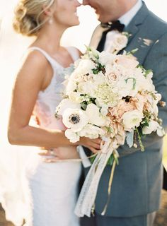 This White and peach wedding bouquet looks so fresh and clean!