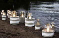 Outdoor dinner table lanterns to light citronella candles at long style dinner table love these!!