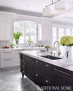 The walnut island, with sink and dishwasher, anchors the kitchen. - Photo: Francesco Lagnese / Design: Nancy Epstein
