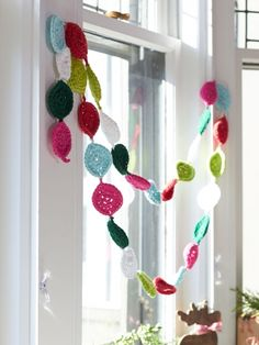 Festive Garland | Yarn | Free Knitting Patterns | Crochet Patterns | Yarnspirations. - this would be cute for the mantle and stairs.  Maybe make in wool and felt the pieces?