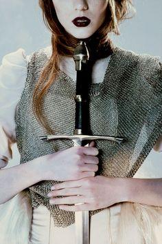 women in armour & dark lipstick