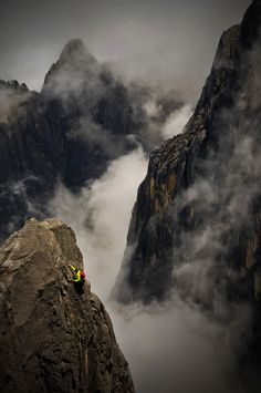 Alex Honnold soloing above the clouds on Mount Kinabalu, a prominent mountain on the island of Borneo in Southeast Asia (Photo by Jimmy Chin)