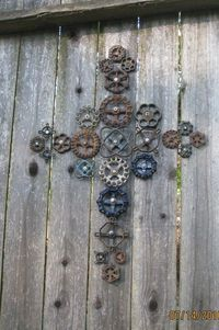 Love this garden art from old outside faucet handles... I just saw a bunch of these the other day in a box at a thrift store...